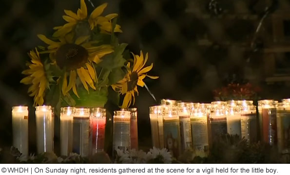 vigil held on Clare street after boy killed by pit bulls